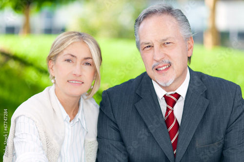 Two business people smiling in an urban setting