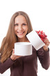 young woman holding white round gift box