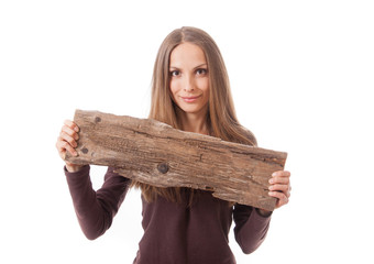 woman holding old wooden board