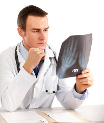 Doctor looking at x-ray on white background