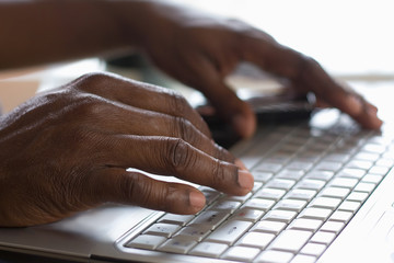 Portrait of an African American typing on the keyboard