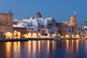 Panoramic nightview of Monopoli seaport. Apulia.