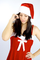 Beautiful female Santa Claus thinking about what gift to bring