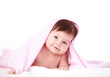 smiling baby looking at camera under a white blanket/towel