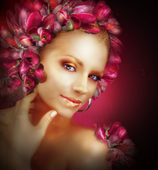 Radiance. Beautiful Golden Girl With Purple Tulips Flowers