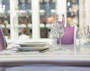 Served fashion table in white colors