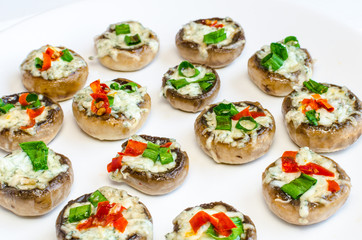 Baked muhrooms with blue cheese, red pepper and spring onion