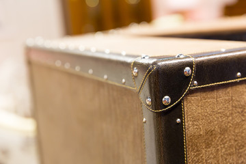 Corner of a worn and frayed vintage suitcase