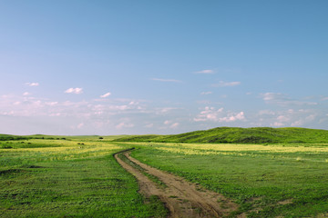 Road in steppe hills