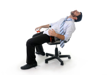 drunk businessman sleeping wasted at office chair
