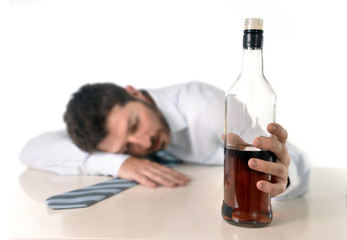 drunk businessman sleeping wasted with whiskey
