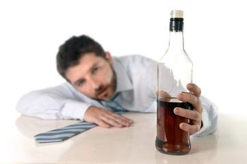 drunk businessman drinking whiskey at office