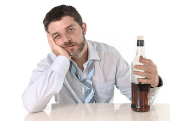 alcoholic drunk businessman drinking whiskey
