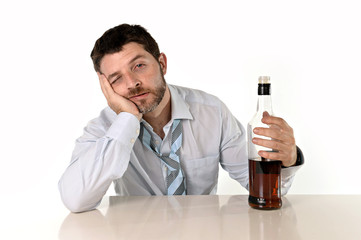 drunk businessman drinking whiskey in office desk