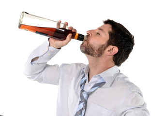 businessman in loose tie  getting drunk with whiskey bottle