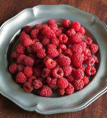 Fresh ripe juicy raspberry in a plate