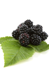 Blackberry fruit with leafs.