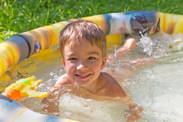 Smiling boy in the swimming-pool