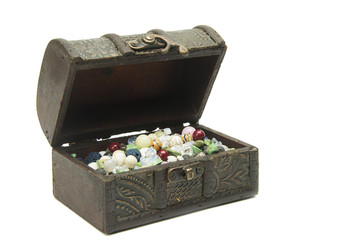 Semi-precious stones in the old wood chest