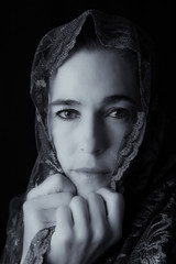 Middle Eastern woman portrait looking sad with hijab artistic co
