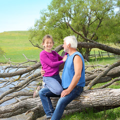 grandfather and granddaughter hugging in nature