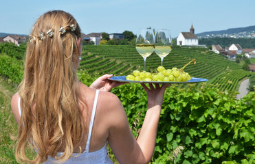 Girl holding wine and grapes. Vineyards of Rheinau, Switzerland