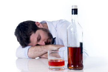alcoholic Business man asleep drunk at desk with hangover
