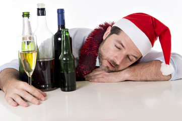 drunk businessman asleep for too much xmas drinking