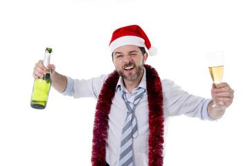 happy drunk businessman drinking champagne in santa hat