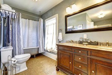 Antique bathroom interior with claw foot tub