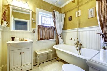 White and yellow antique bathroom interior