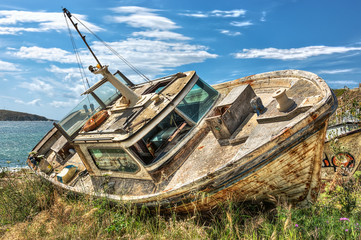 Abandoned beached boat in Mykonos