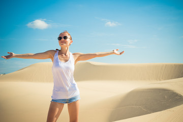 Beautiful woman in sand dunes