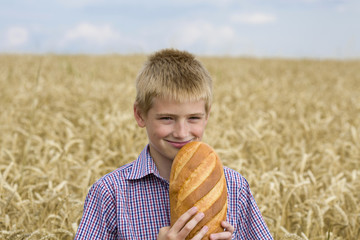 Happy child holding bread