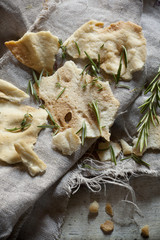 Bread crisp with rosmary on rustic backgroun with jute napkin