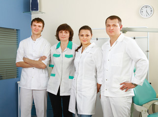 Medical doctors standing in office