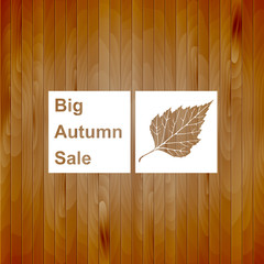 Big autumn sale sign, white silhouette on wood background