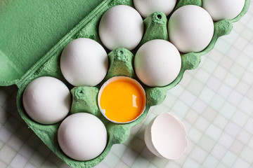 White eggs in a green box