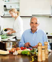 mature man helping his wife in household work