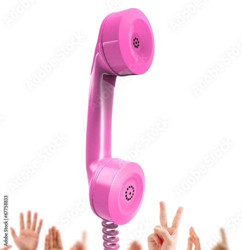pink phone, hands in the background
