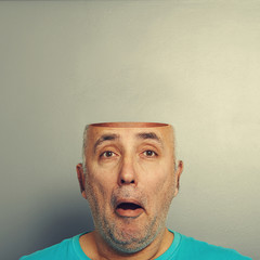 amazed senior man with open head