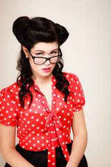 Retro. Portrait of pinup girl in eyeglasses