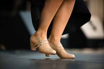 Dancers performing Argentinian tango - legs close-up