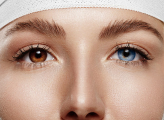 closeup woman's eyes with Heterochromia iridum