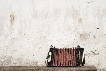 wall and accordion on the bench background