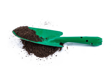 Gardening shovel on soil