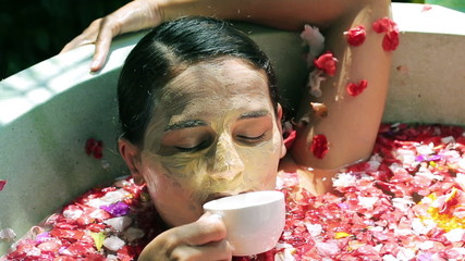 Woman relaxing and drinking coffee in the spa