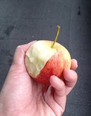 red apple in hand, fresh delicious