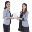 businesswomen giving a box to her