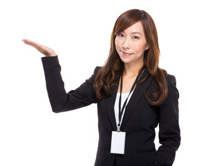 Asian businesswoman with open hand plam